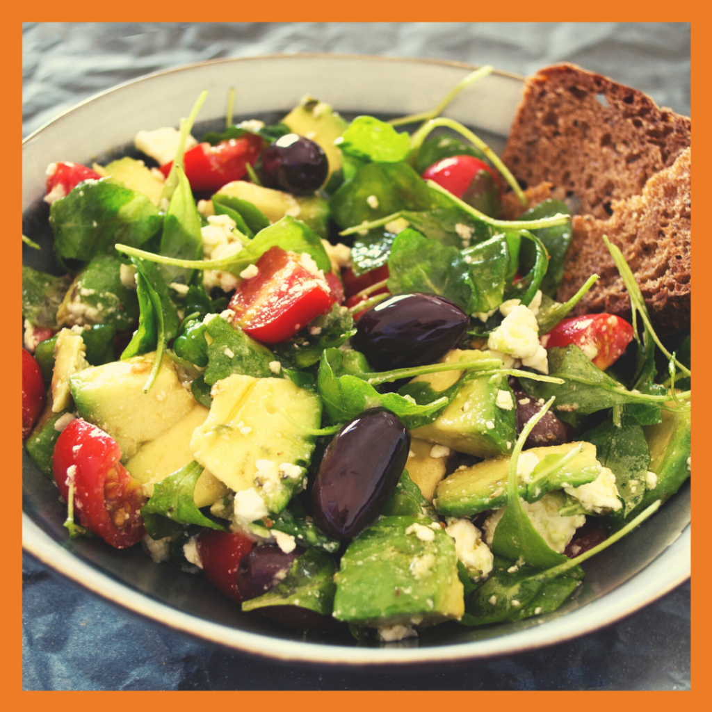 Salad in a bowl with tomatos, avocado, lettuce and beans