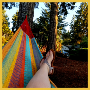 Feet of a person laying in a hammock
