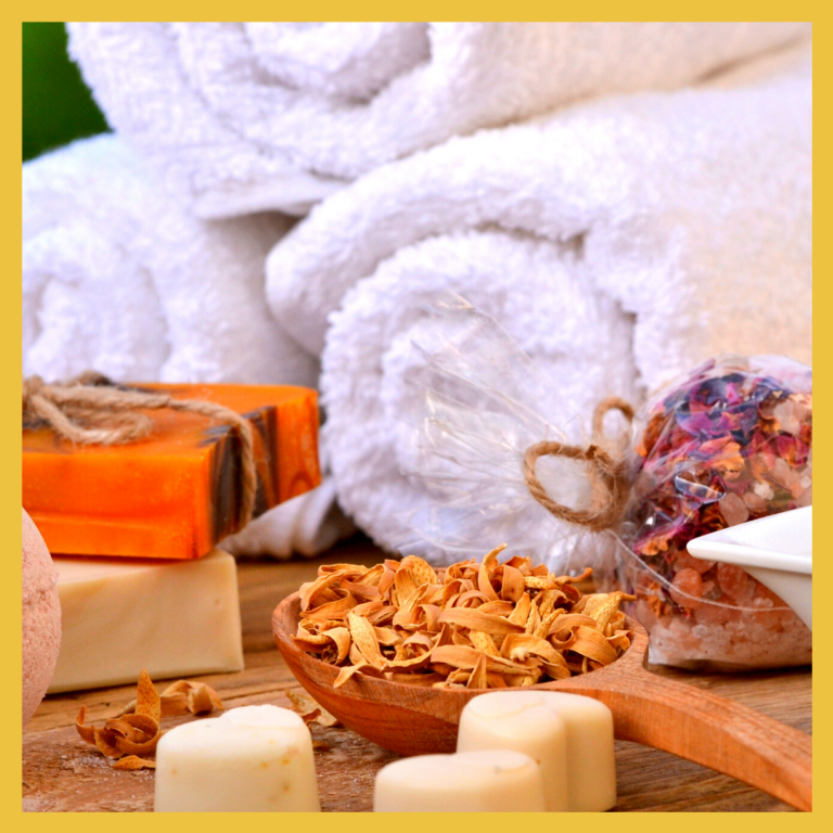 Rolled towels, candles, soaps and other spa items