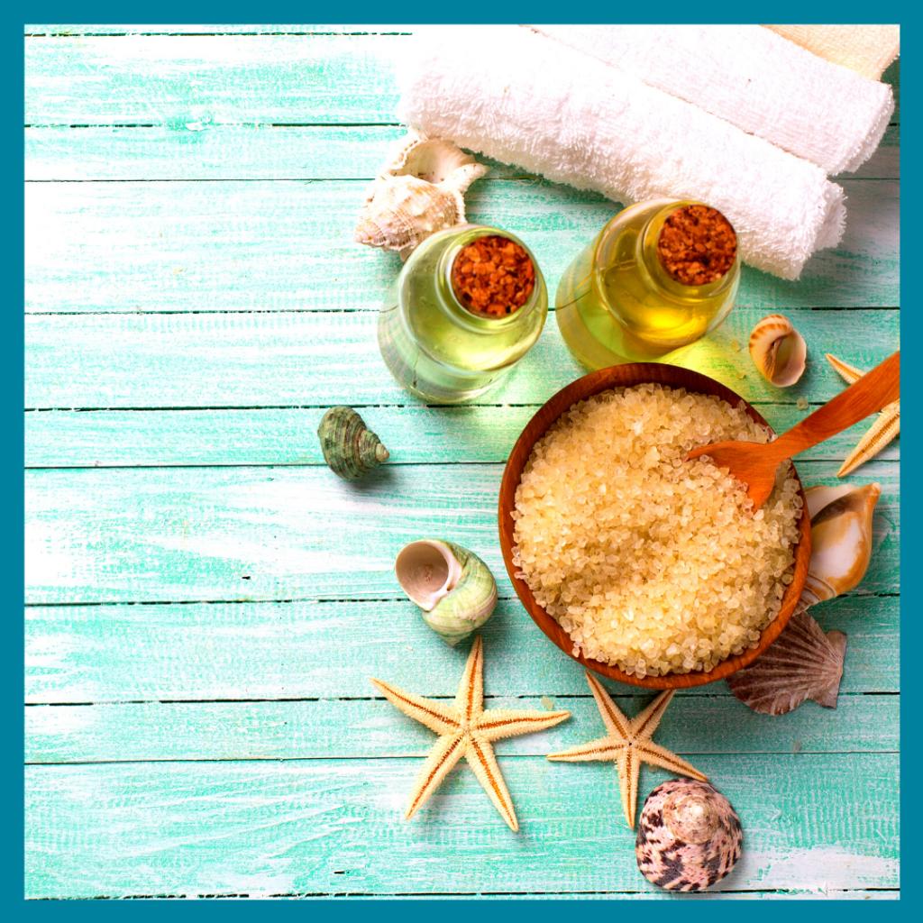 Starfish, seas salt, oils and towels on a blue table
