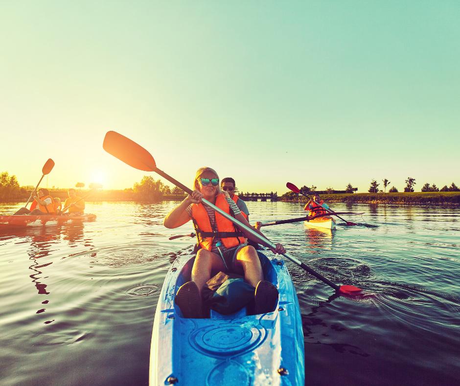 People kayaking in a blue kayak