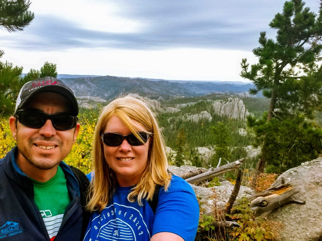 Selfie of a Guy and Girl with a view of the black hills